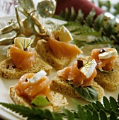 Canapes with smoked salmon and camembert