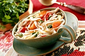 Spicy chicken and rice noodle soup