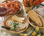 Hearty snack: olive bread with herb quark, cheese and ham