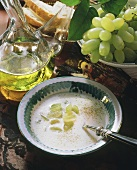 Cold grape and almond soup with grapes and oil carafe
