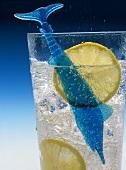 A glass of mineral water with lemon slices