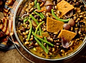 Bean stew with polenta slices