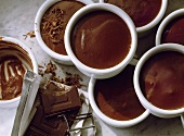Chocolate flummery in china dishes with chocolate