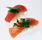 Two nigiri sushi with green pepper animal figures