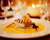 Grilled tuna on noodles with saffron sauce