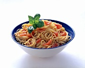 Spaghetti with fresh tomatoes in a dish