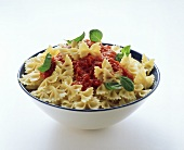 Farfalle with tomato sauce and basil in a dish