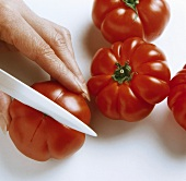 Cutting a cross into a beefsteak tomato