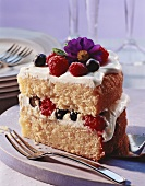 A piece of sponge gateau with berries