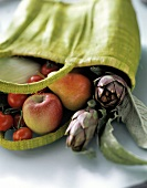 Yellow shopping bag with fruit and vegetables