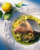 Steamed salmon fillet on ribbon pasta and lemon and dill sauce