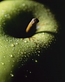 Granny Smith apple with drops of water