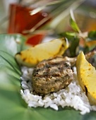 Grilled lamb cutlet with lemon wedges and rice