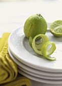 Limes and Lime Peel on Plate