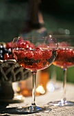 Champagne with berries in glass