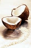 A halved coconut with grated coconut