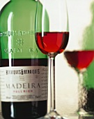 A glass of Madeira, bottle in background