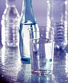 Glass of Mineral Water with Bottles