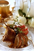 Duck leg, carved, with baked apples and dumplings
