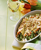 Crespelle filled with green asparagus and baked