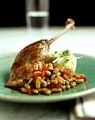 Rabbit leg with beans & tomatoes and mashed potato