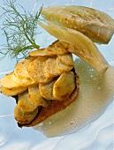 Salmon trout under a potato crust