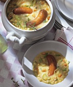 Pea soup with sausages in a soup tureen