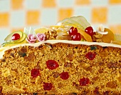 A rich sponge cake with candied fruit, cut in half