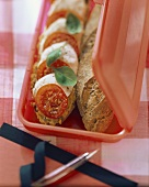 Grain baguette sandwich with tomatoes and mozzarella in sandwich box