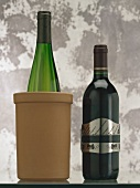 Wine bottles in clay cooler and with thermometer band