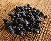 Juniper berries on a brown background