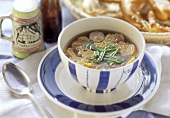 Pretzel soup with chives in soup bowl