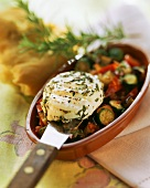 Vegetable casserole with fried goat's cheese