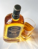 A bottle and a glass of Tullamore Dew (Irish whiskey)