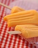 Mango ice cream on a stick