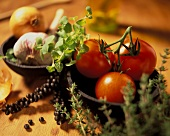 Still life with tomatoes, herbs, garlic and onion