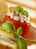 Beefsteak tomato stuffed with cottage cheese and basil