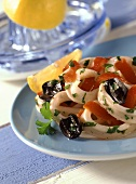 Cuttlefish salad with pepper strips and olives