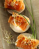 Salmon roll with goat's cheese on radish slice