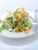 Carrot salad (curly carrots) with sheep's cheese