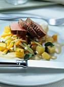 Marinated pork fillet on julienne vegetables