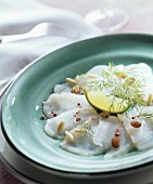 Sturgeon carpaccio with fennel fronds