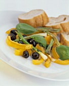 Warm pepper salad with olives an spring onions