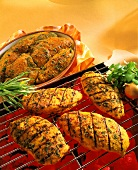 Marinated chicken pieces on grill and on plate