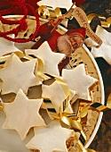 Cinnamon stars with Christmas decoration on plate