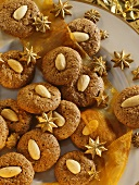 Chocolate almond macaroons with stars on gold-rimmed plate