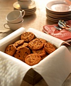 Chocolate chip cookies in a biscuit tin