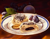 Yeast dumpling with plum puree and poppy seeds