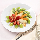 Fruit plate with grapes, strawberries, kiwi slices etc