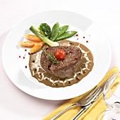 Peppered steak on sauce